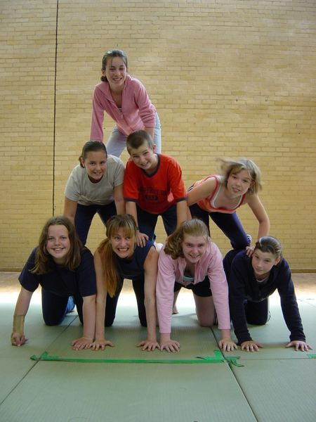 Acro pyramid young people in a gym