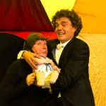 Rollover Beethoven cradling puppet baby